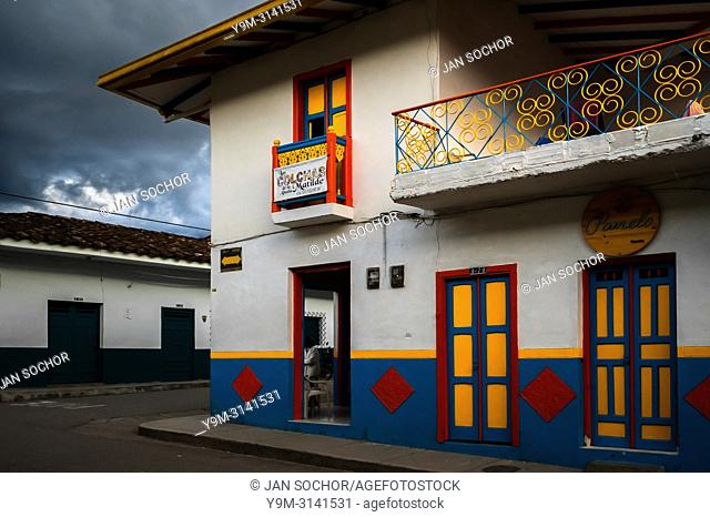 A brightly painted colonial house is seen before a rain storm in Jardín, a village in the coffee region (Zona cafetera) of Colombia, 24 April 2018