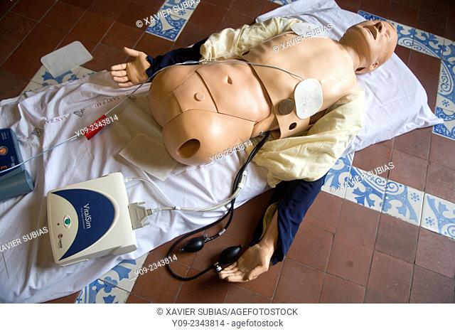 CPR being performed on a medical-training manikin