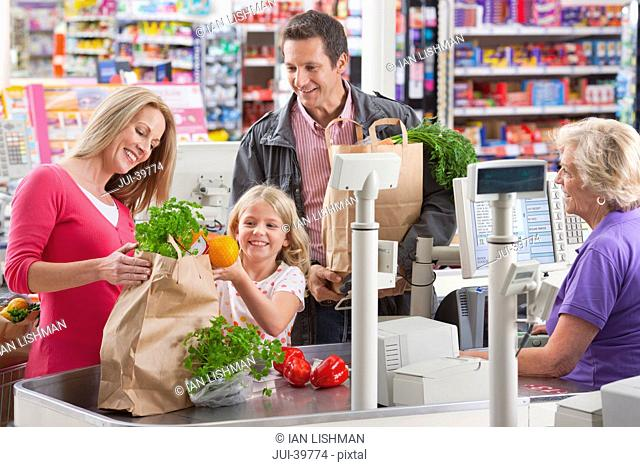 family, packing, buying, shopping, supermarket, checkout, cashier