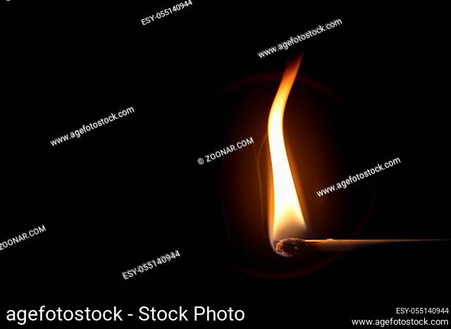 An image of a match flame dark background