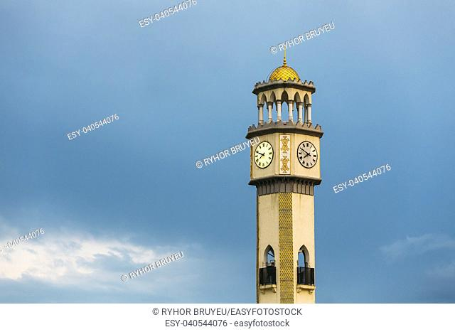 Batumi, Adjara, Georgia. Close Up Of Chacha Tower On Blue Evening Sky Background. Local Landmark. Tower Is Surrounded By 4 Fountain Pools With Chacha