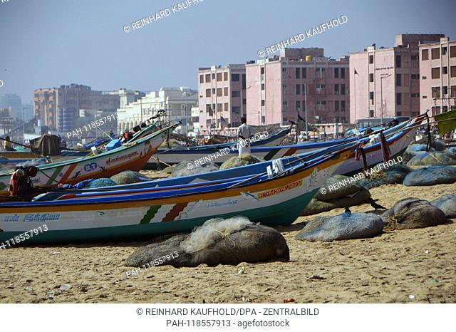 Fishing boats are located on the beach of Chennai (Madras) in South India - the beach on the Bay of Bengal is one of the longest sandy beaches in the world