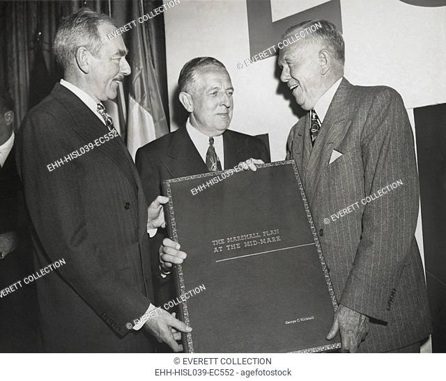 Celebration of the 2nd Anniversary of the Marshall Plan. Secretary of State Dean Acheson (left) and Economic Cooperation Administrator Paul Hoffman (center)...