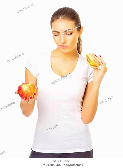 Young woman with apple and hamburger