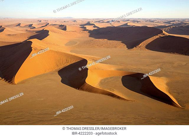Sand dunes in the Namib Desert, in the evening, aerial view, Namib-Naukluft National Park, Namibia