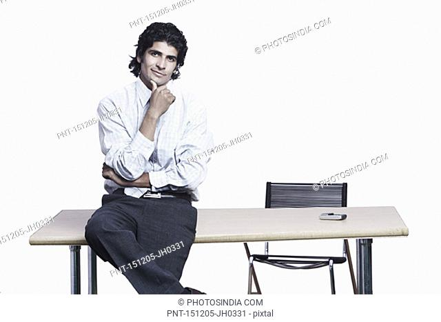 Portrait of a businessman sitting on the table