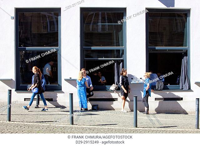 Czech Republic, Prague - People outside of popular Cafe Cobra
