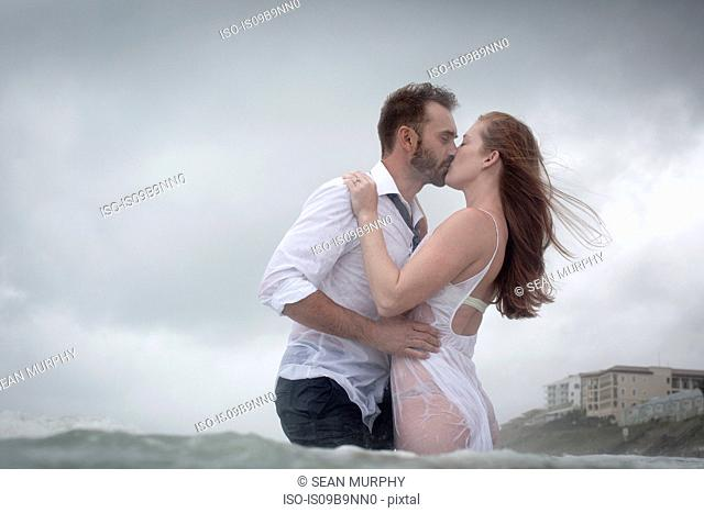 Couple in sea kissing