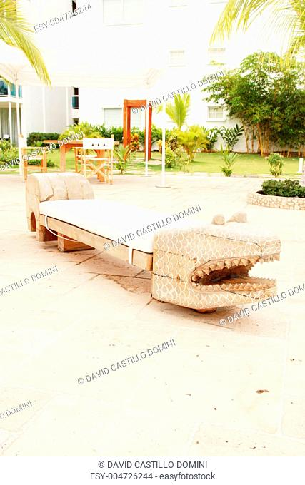 Home exterior patio with handcraft wooden sofa with an aligator