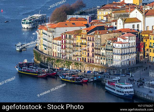 Tourist boats and ships over Douro River in Porto city on Iberian Peninsula, second largest city in Portugal. View from Vila Nova de Gaia city