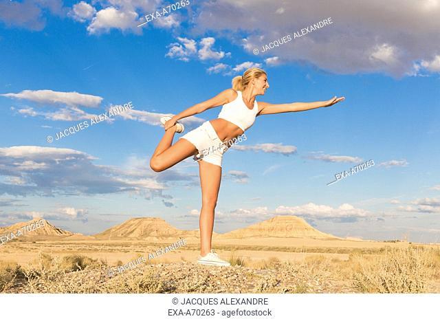 woman exercises in the desert