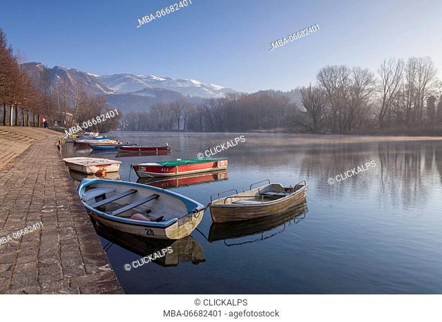 Brivio, Adda north park, Lecco province, Lombardy, Italy. Some boats at the Brivio's port at a winter morning