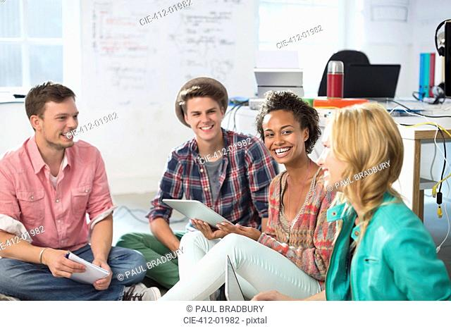 Business people laughing in meeting