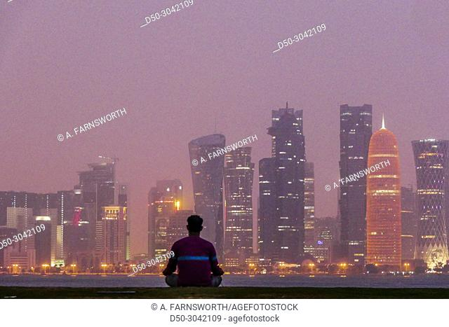 Peace, mindullness and yoga in the park overlooking West Bay. Doha, Qatar