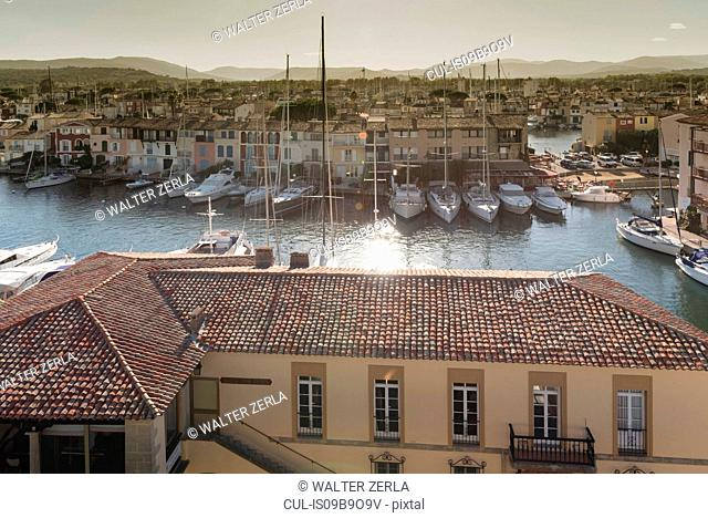 Elevated view of rooftops and yachts moored on waterfront in Grimaud, Provence-Alpes-Cote d'Azur, France