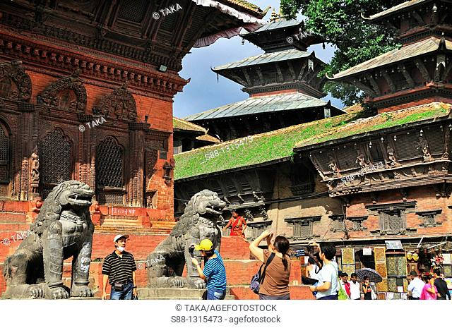 In front of Shiva Parvati temple in Hanuman Dhoka Durbar world heritage monument zone, Nepali and foreign tourists taking pictures