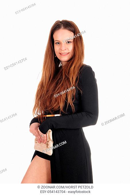 A close up image of a beautiful young woman wearing a black dress and long brunette hair, isolated for white background