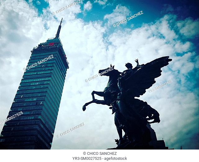 The Torre Mayor building and a sculture of a Greek Pegaso decoratin the Palacio de Bellas Artes in Alameda Central Park in Mexico City, Mexico
