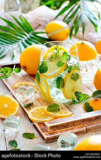 Homemade refreshing lemonade made from citrus fruits close up