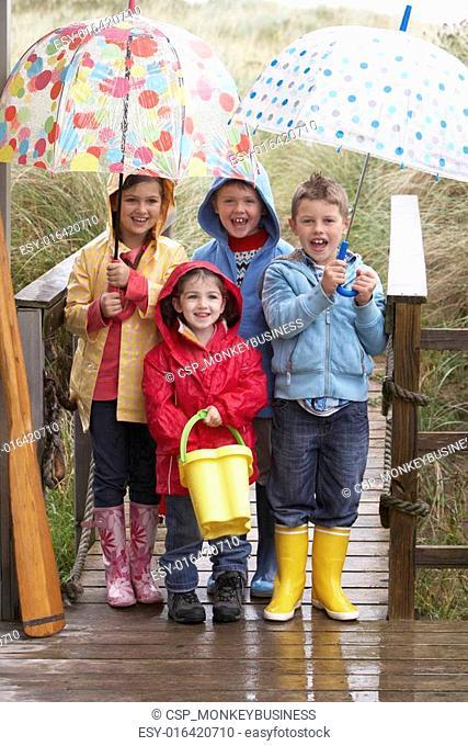 Children posing with umbrella