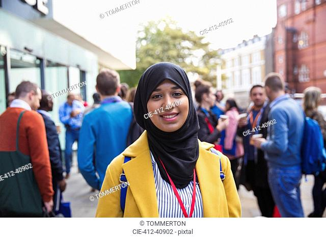 Portrait smiling, confident businesswoman in hijab on street