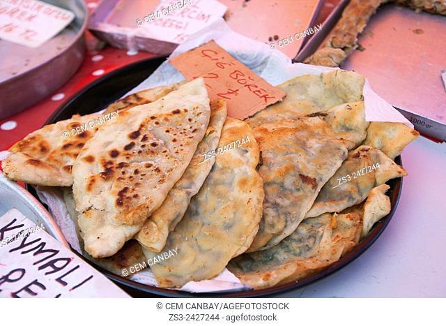 Turkish traditional Cig Borek at the market in Sigacik town, Izmir Province, Aegean Coast, Turkey, Europe