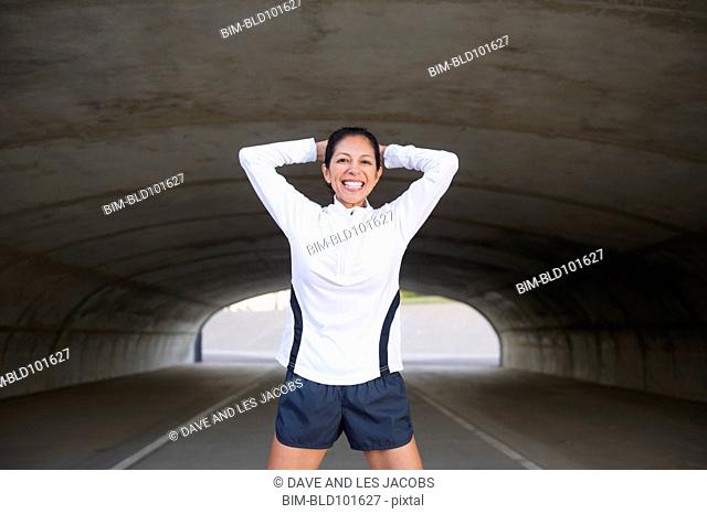 Smiling Hispanic woman in tunnel