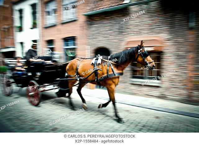 Tours in horse carriages in the center of Bruges, Flanders, Belgium