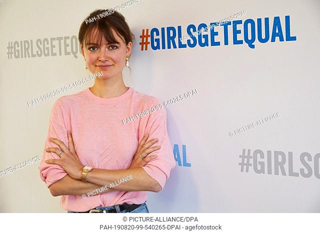 "20 August 2019, Hamburg: Hannah Müller-Hillebrand, influencer and Plan ambassador, is standing in front of a wall with the hash tag """"Girlsgetequal"""" after a..."