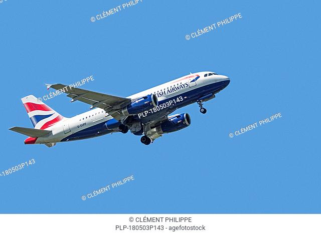 Airbus A319-131, narrow-body, commercial passenger twin-engine jet airliner from British Airways in flight against blue sky