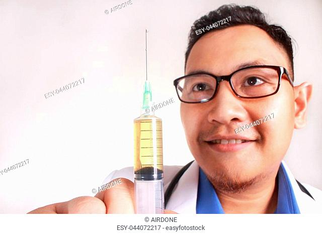 A Young Asian doctor with eyeglass hold a Syringe. Smiling. Isolated on white background