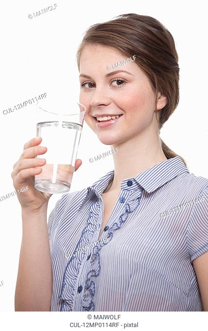 Young women holding a glass of water