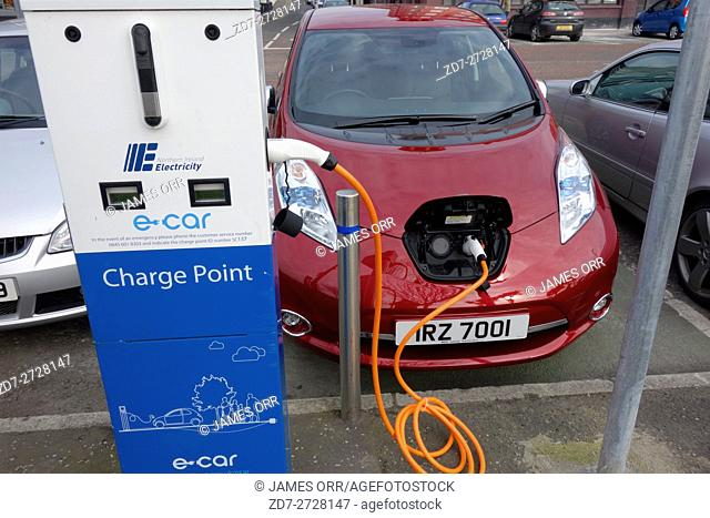 Electric car plugged into a charging point, Bangor, Co. Down, Northern Ireland