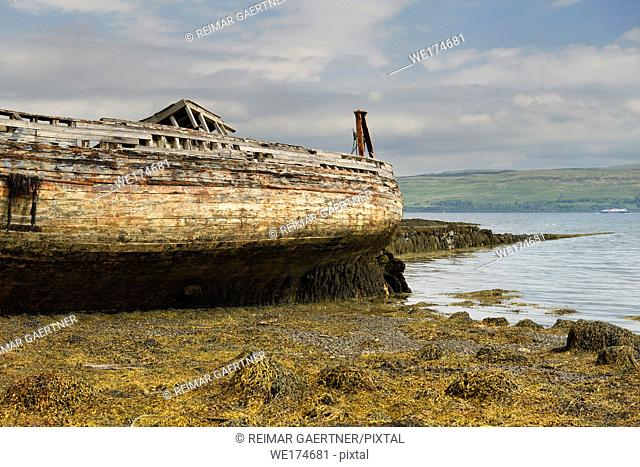 Shipwreck on Salen beach with seaweed at low tide on Sound of Mull Isle of Mull Scotland UK