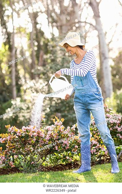 Pretty brunette doing some gardening activities