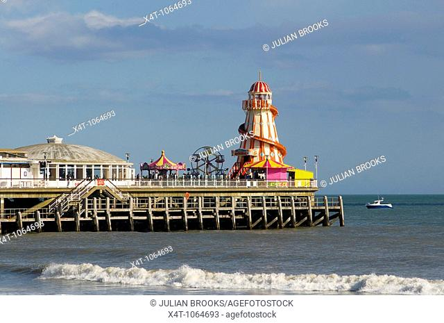The Victorian Pier at Bournemouth UK with a fairground at the end, sunny day