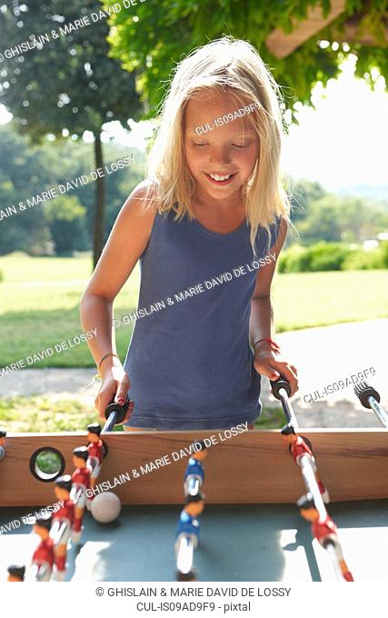 Girl playing foosball