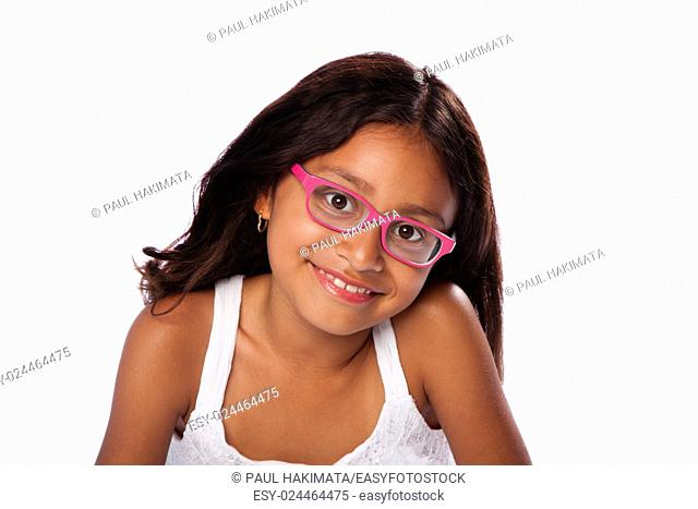 Cute happy smiling Latina Hispanic girl with pink glasses, on white background