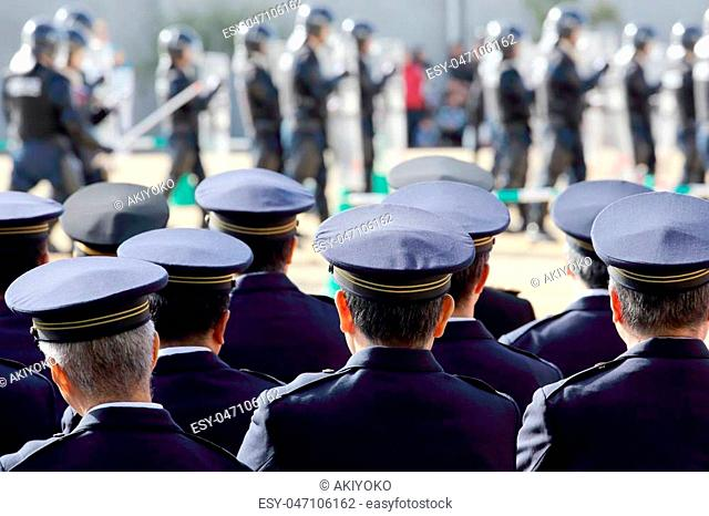 Back view of Japanese police officers, Sietusiki ceremony