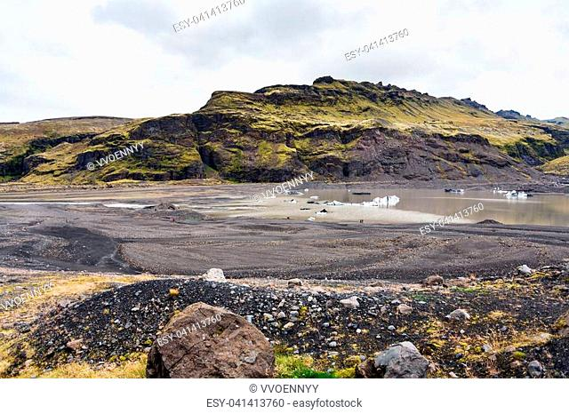 travel to Iceland - melting ice in bed of Solheimajokull glacier (South glacial tongue of Myrdalsjokull ice cap) in Katla Geopark on Icelandic Atlantic South...