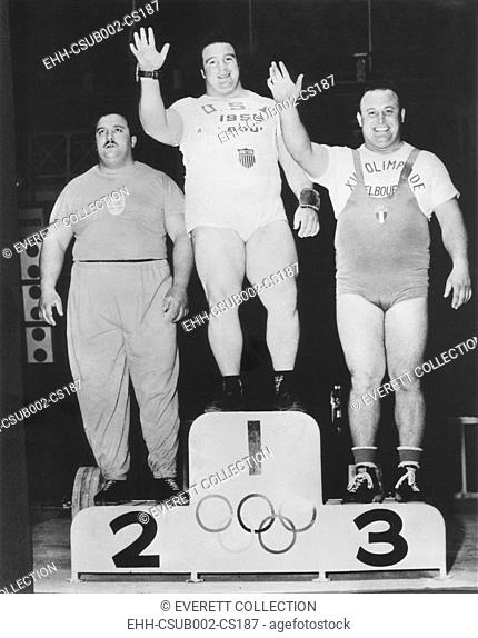 Paul Anderson (center) won a Olympic Gold Medal in heavyweight weightlifting. Melbourne, Australia Games, Nov. 26, 1956. At left is Argentina's Humberto...