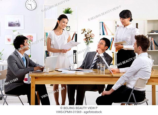 A group of people having a meeting in studio