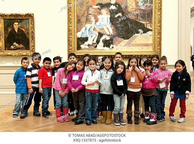 Metropolitan Museum of Art, New York City, public elementary school children during a field trip posing besides an Auguste Renoir painting