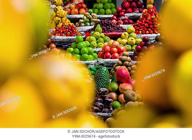 Piles of fruits (apples, pears, mangos, strawberries, guanabanas etc. ) are seen arranged at the fruit market of Paloquemao in Bogotá, Colombia