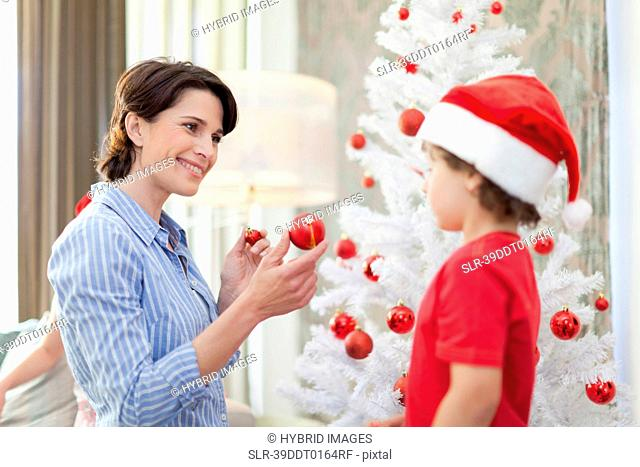 Mother and son decorating Christmas tree