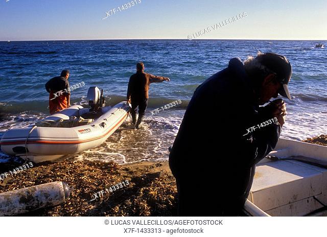 Agua amarga beach  Fishermen  Cabo de Gata-Nijar Natural Park  Biosphere Reserve, Almeria province, Andalucia, Spain