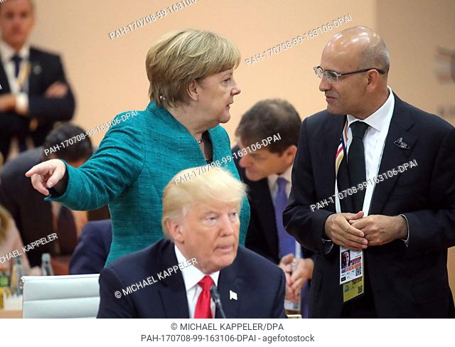 German chancellor Angela Merkel (L-R), American president Donald Trump and Turkish finance minister Mehmet Simsek at the Partnership with Africa working session
