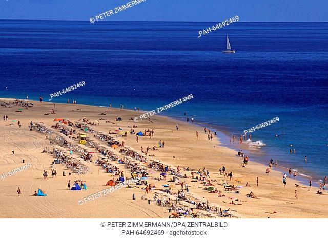 Tourists enjoy the summerly weather on the beach near Morro Jable on the Canary Island Fuerteventura, Spain, 12 October 2015