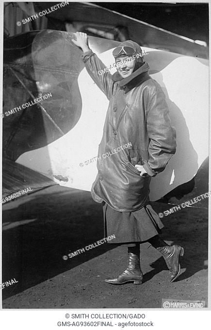 The only woman granted a pilot's license by the US Army and Navy Committee of Aeronautics, Marjorie Stinson poses beside an aircraft