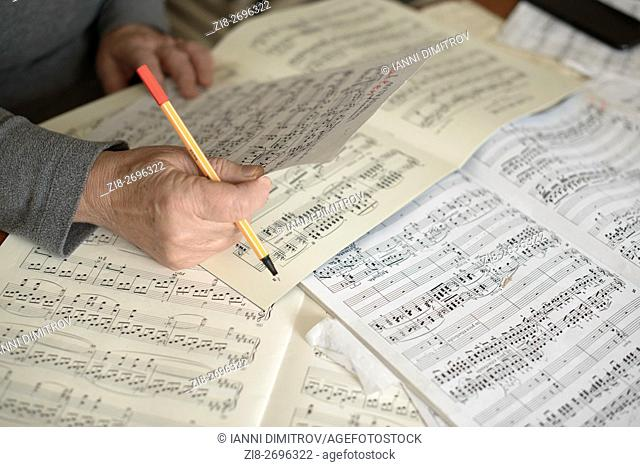 Musician reading music scores at first rehearsal